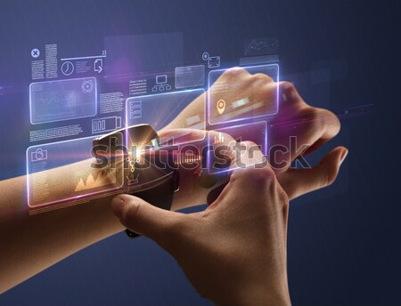 Close up hand with smartwatch and numbers Stock photo © ra2studio