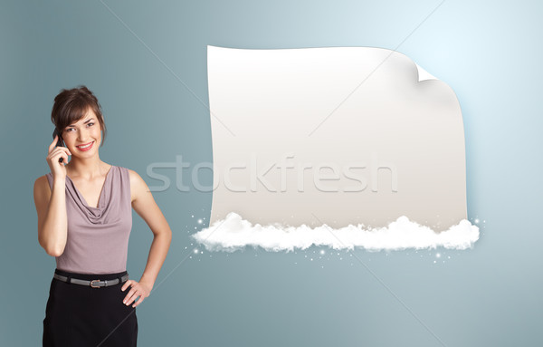 pretty young woman making phone call and presenting modern copy space on clouds Stock photo © ra2studio