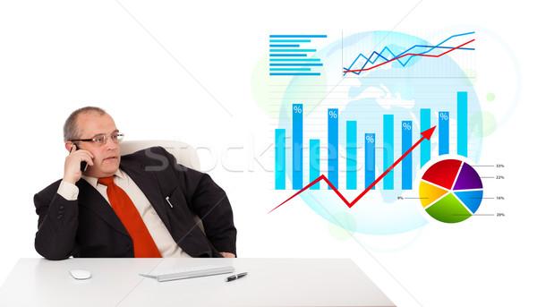 üzletember ül asztal statisztika készít telefonbeszélgetés Stock fotó © ra2studio