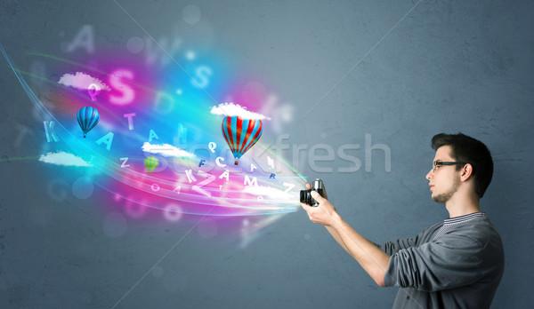 Jóképű fotós kamera absztrakt képzeletbeli fiatal Stock fotó © ra2studio