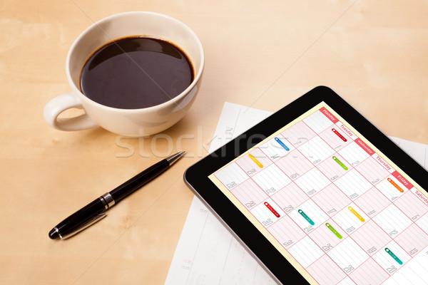 Werkplek tonen kalender beker koffie Stockfoto © ra2studio