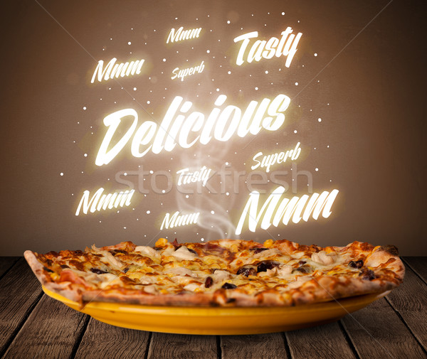 Pizza with delicious and tasty glowing writings Stock photo © ra2studio