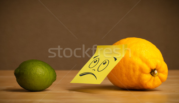 Lemon with sticky post-it note looking sadly at lime Stock photo © ra2studio