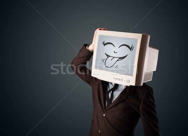 Happy business man with a computer monitor and a smiley face Stock photo © ra2studio