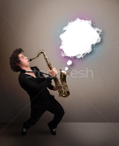 Jeune homme jouer saxophone espace de copie blanche nuage Photo stock © ra2studio