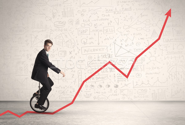 Business parson riding unicycle on an uprising red arrow  Stock photo © ra2studio