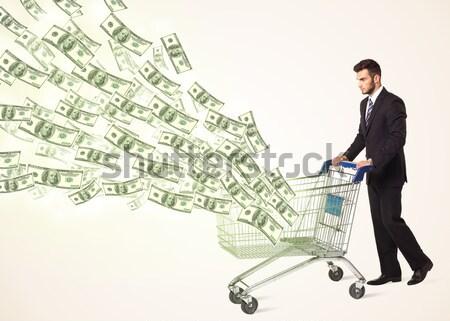 Zakenman winkelwagen voortvarend uit winkelen Stockfoto © ra2studio