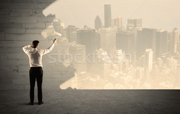Salesman painting city scape on wall Stock photo © ra2studio