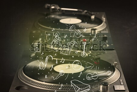 Stock photo: Turntable playing classical music with icon drawn instruments