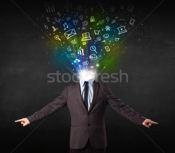 Business man with glowing media icons exploding head  Foto stock © ra2studio