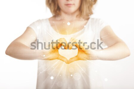 Hands creating a form with yellow shines Stock photo © ra2studio