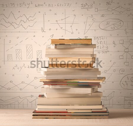 A pile of books with math formulas written in doodle style Stock photo © ra2studio