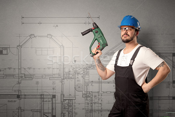 Worker with technical drawing. Stock photo © ra2studio
