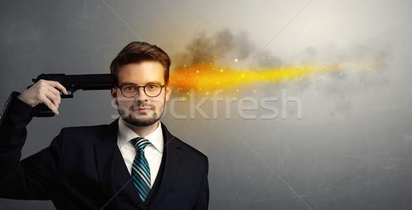 Empresário tiroteio cabeça pistola homem luzes Foto stock © ra2studio