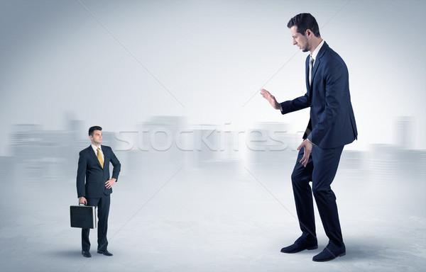 Gigant biznesmen przestraszony mały poważny człowiek Zdjęcia stock © ra2studio