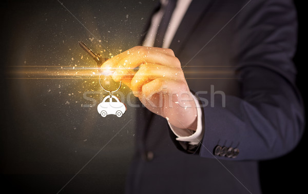 Man hand over keys Stock photo © ra2studio