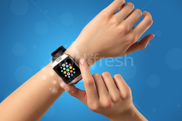 Female hand with smartwatch and app icons Stock photo © ra2studio