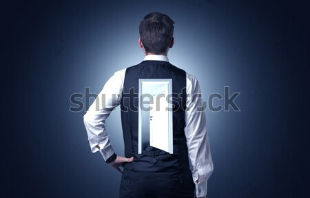 Businessman standing with door on his back Stock photo © ra2studio