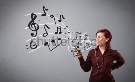 Vonzó fiatal hölgy énekel zenét hallgat hangjegyek Stock fotó © ra2studio