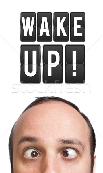 Funny Young man with wake up sign over head Stock photo © ra2studio