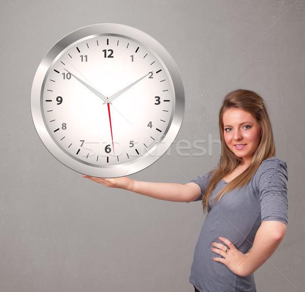 Vonzó hölgy tart hatalmas óra fiatal Stock fotó © ra2studio