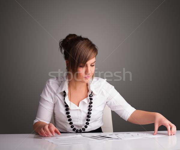 女性実業家 座って デスク 書類 美しい 小さな ストックフォト © ra2studio