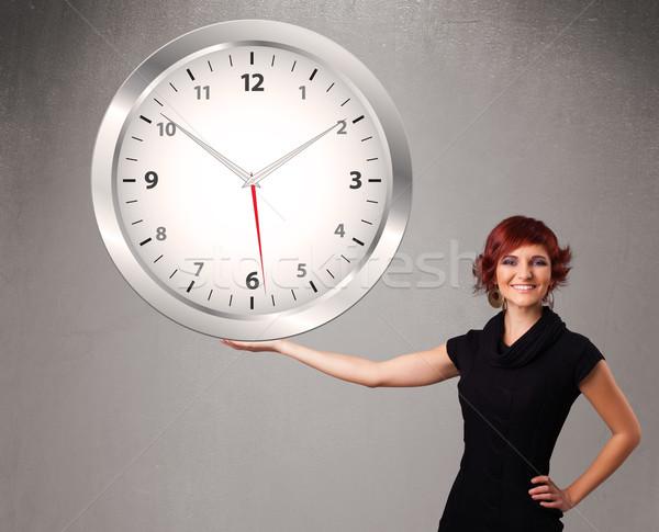 Attrattivo signora enorme clock giovani Foto d'archivio © ra2studio