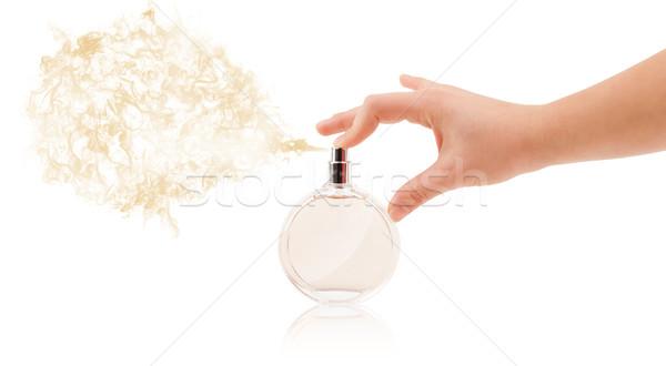 woman hands spraying perfume Stock photo © ra2studio