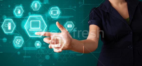 Girl pressing virtual media type of buttons Stock photo © ra2studio