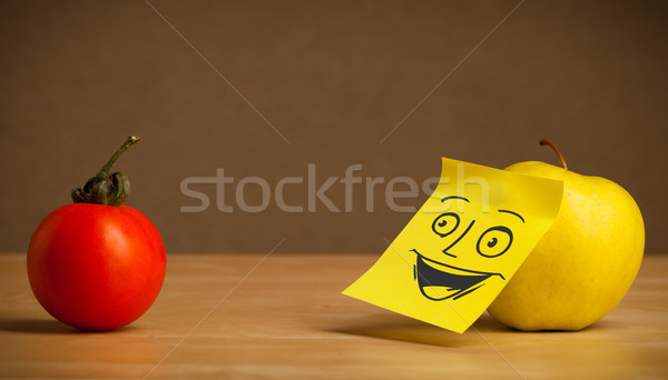 Stock photo: Apple with post-it note smiling at tomato