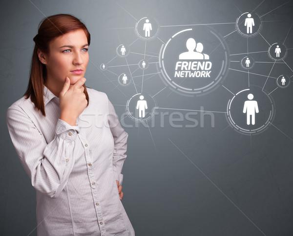 魅力的な女の子 見える 現代 社会的ネットワーク 魅力的な 若い女の子 ストックフォト © ra2studio