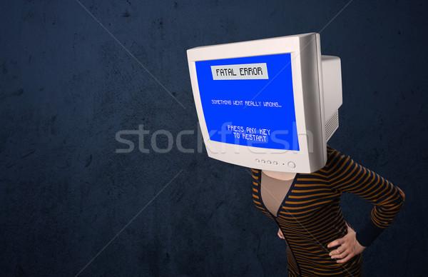 Person with a monitor head and fatal error blue screen on the di Stock photo © ra2studio
