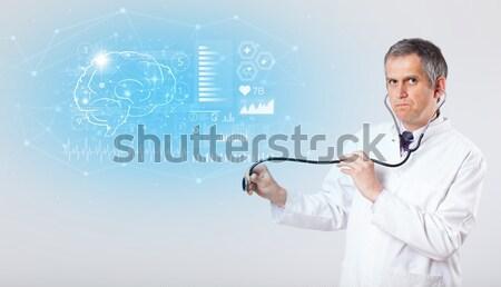 Doctor examinating modern heartbeat graphics Stock photo © ra2studio