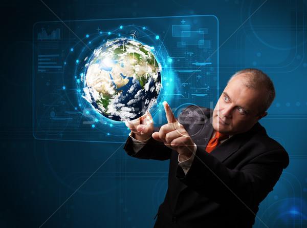 Stockfoto: Zakenman · aanraken · 3D · aarde · paneel · permanente