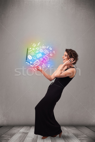 Young lady holding notebook with colorful hand drawn multimedia  Stock photo © ra2studio