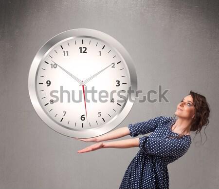Attractive lady holding a huge clock Stock photo © ra2studio