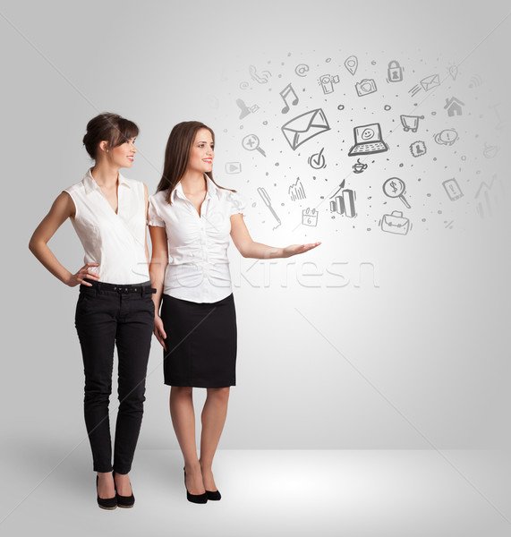 Business girl presenting hand drawn sketch graphs and charts Stock photo © ra2studio