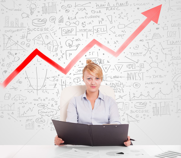 Business woman sitting at table with market diagrams  Stock photo © ra2studio