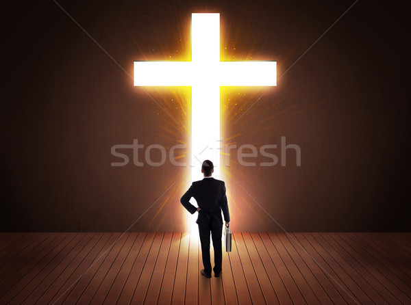Man looking at bright cross sign  Stock photo © ra2studio