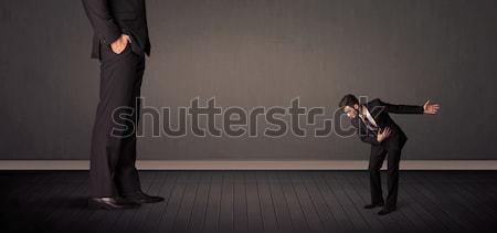 Piccolo gigante boss gambe ufficio sfondo Foto d'archivio © ra2studio