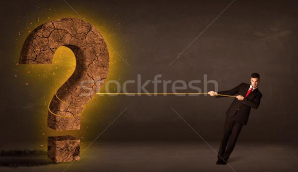 Hombre de negocios grande sólido signo de interrogación piedra Foto stock © ra2studio