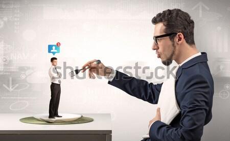 бизнесмен сокрытие оружием белый молота Сток-фото © ra2studio