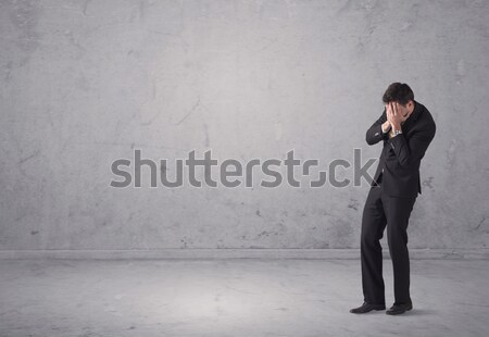 Young businessman standing confused Stock photo © ra2studio