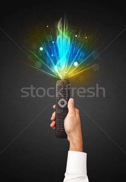 Main télécommande explosive signal brillant Photo stock © ra2studio