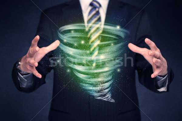 Businessman holding green tornado Stock photo © ra2studio