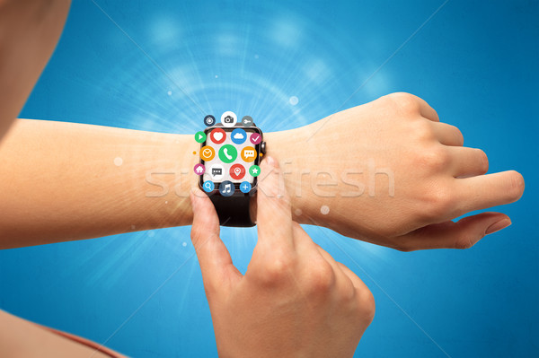 Smartwatch with application icons. Stock photo © ra2studio