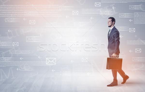 Businessman walking with mail concept around Stock photo © ra2studio