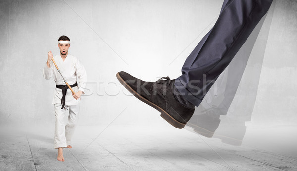 Big foot trample karate trainer concept Stock photo © ra2studio