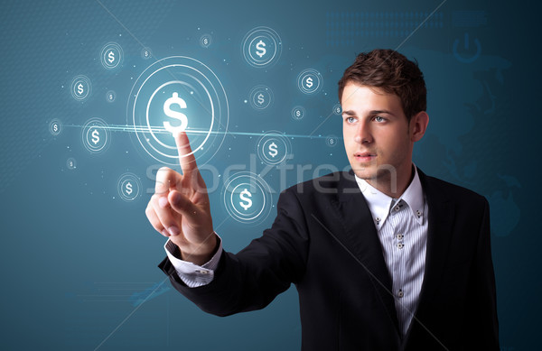 Businessman pressing modern business type of buttons Stock photo © ra2studio