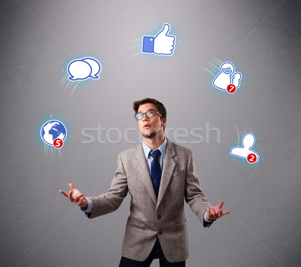 Stock photo: handsome young boy juggling with social media icons